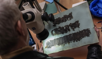 David Blank, a professor from the University of California, examines the scrolls at the Naples' National Library, pompeii
