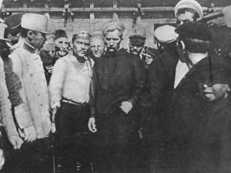The Potemkin mutineers—Afanasy Matyushenko is in the center left in the white shirt.