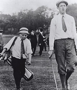 Francis Ouiment and caddy Eddie Lowery at the 1913 U.S. Open. (Credit: Ouiment College Scholarship Fund)
