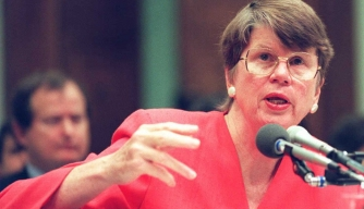U.S. Attorney General Janet Reno testifies to a House subcommittee on Capitol Hill in Washington about the 1993 raid on the Branch Davidian compound near Waco, Texas. (Credit: DAVID AKE/AFP/Getty Images)