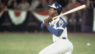 Hank Aaron hits home run 715, breaking Babe Ruth's record, on April 8, 1974.