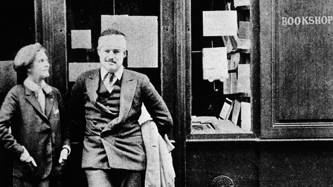 Hemingway and bookseller Sylvia Beech outside Beech's Paris store, Shakespeare and Company, 1920s.