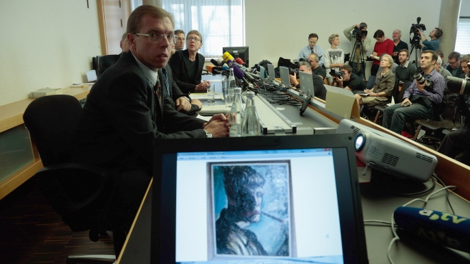 Art historian Meike Hoffmann speaks to the media regarding the seizure of 1,500 paintings from Cornelius Gurlitt on November 5, 2013. (Credit: Johannes Simon/Getty Images)