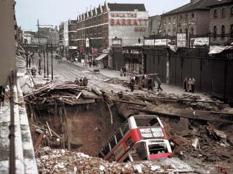Damage in Balham, London, following a nighttime air raid on October 14, 1940. (Credit: William Vandivert/The LIFE Picture Collection/Getty Images)
