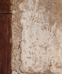 A view of the newly discovered inscriptions, located next to a window above the Alamo church's main entrance. (Credit: Jeff Jowdy/Jowdy Photography)