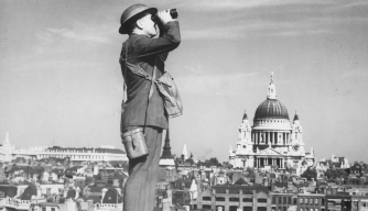 An aircraft spotter on the roof of a building in London, with St. Pau's Cathedral in the background. (Credit: New York Times Paris Bureau Collection/National Archives)