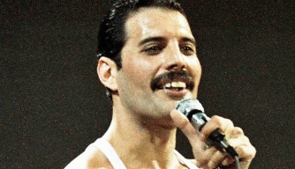 Freddie Mercury of Queen performs on stage at Live Aid on July 13th, 1985.