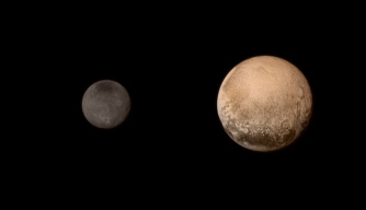 A shot from New Horizons of Pluto and Charon taken on July 11, 2015. (Credit: NASA/JHUAPL/SWRI)