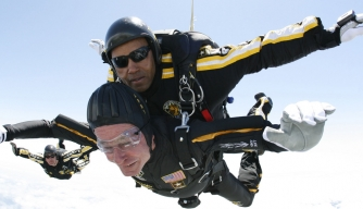 George H.W. Bush skydives with the U.S. Army Golden Knights parachute team on his 85th birthday. (Credit: U.S. Army/Associated Press)