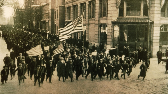 Striking workers parade through the streets of Lawrence, Massachusetts, during the 1912 Bread and Roses strike. (Lawrence History Center)