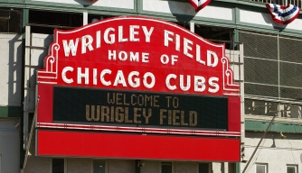 "CHICAGO - OCTOBER 13:  The ""Wrigley Field Home Of The Chicago Cubs"" marquee is visible October 13, 2003 Chicago, Illinois. The Cubs are one win away from playing in their first World Series since 1949.  (Photo by Tim Boyle/Getty Images)"