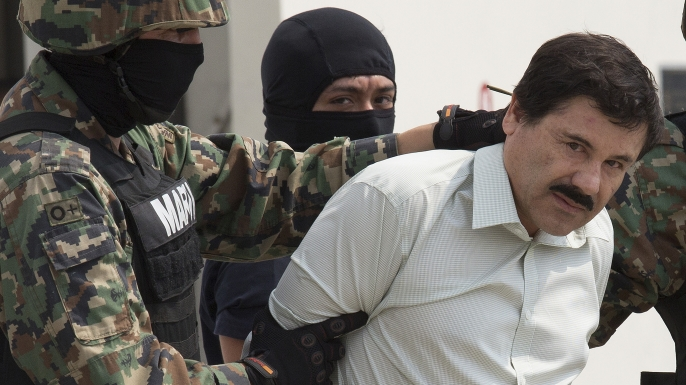 "Drug trafficker Joaquin ""El Chapo"" Guzman is escorted to a helicopter by Mexican security forces. (Credit: Susana Gonzalez/Getty Images)"