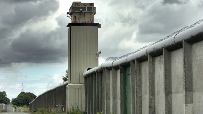 A watchtower and perimeter wall marks the boundary of the former Maze Prison, west of Belfast in Northern Ireland.  (Credit: Paul Mcerlane/Getty Images)