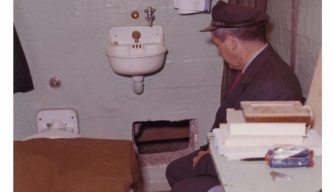 Federal Officer sitting in Frank Morris's cell after 1962 escape.