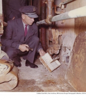 Alcatraz Correctional Officer investigating the 1962 escape in the utility corridor behind the cell #152.