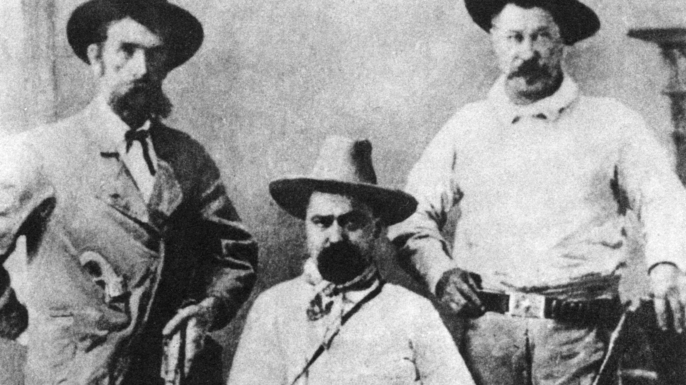 William Pinkerton, flanked by two agents. (Credit: The Print Collector/Print Collector/Getty Images)