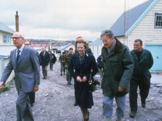 British Prime Minister Margaret Thatcher and her husband Denis visit Stanley Junior School, in the Falkland Islands, 1983. (Credit: Keystone/Getty Images)