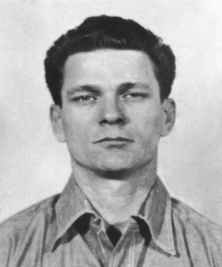 A police mug shot of American criminal Frank Lee Morris taken on his arrival at Alcatraz Federal Penitentiary, 20th January 1960. (Credit: Pictorial Parade/Getty Images)