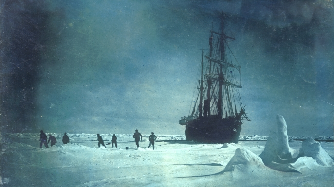 Soccer on the floe whilst waiting for the ice to break up around the Endurance, 1915, during the Imperial Trans-Antarctic Expedition. (Credit: Frank Hurley/Getty Images)
