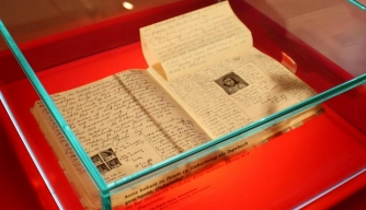 Facsimile of the diary of Anne Frank on display at the Anne Frank Zentrum in Berlin, Germany. (Credit: Anne Frank Zentrum)