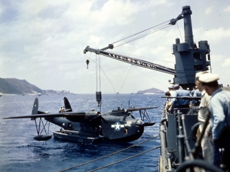 A Martin PBM Mariner suspended from a ship's stern crane. (Credit: PhotoQuest/Getty Images)