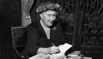 British mystery author Agatha Christie autographing French editions of her books.  (Credit: Hulton Archive/Getty Images)