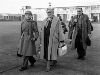 English crime writer Agatha Christie at London Airport with her grandson, Matthew Pritchard.  (Credit: Keystone/Getty Images)