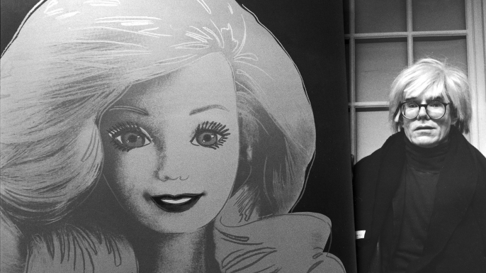 Artist Andy Warhol displaying his portrait of a Barbie doll.  (Credit: DMI/The LIFE Picture Collection/Getty Images)