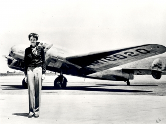 Amelia Earhart standing in front of the Lockheed Electra.  (Credit: SSPL/Getty Images)