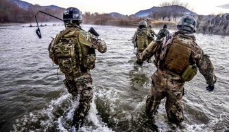 U.S. Special Forces cross a wide river during a clearance operation in Gaza Valley, Arghandab district, Zabul province, Afghanistan, Dec. 11, 2013. (Credit: U.S. Department of Defense)