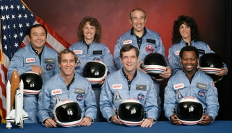 "The Challenger crew. Back row (L-R): Ellison Onizuka, Christa McAuliffe, Gregory Jarvis, Judith Resnick. Front row (L-R): Michael J. Smith, Francis ""Dick"" Scobee, Ronald McNair."