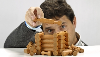 Man with Lincoln logs. (Credit: David Cooper/Toronto Star/Getty Images)