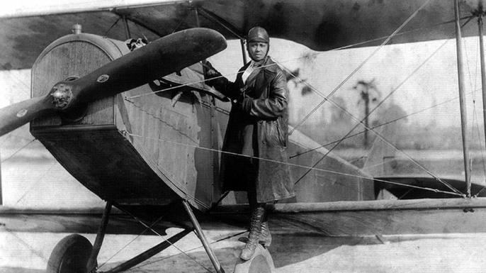 Bessie Coleman and her plane in 1922. (Credit: Public Domain)