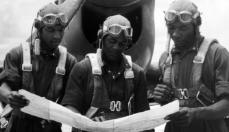 Tuskegee Airmen prepare for a flight from Tuskegee Army Airfield, 1943. (Credit: Afro American Newspapers/Gado/Getty Images)