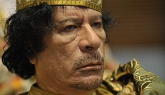Muammar Qaddafi, the Libyan chief of state. (Credit: U.S. Navy)