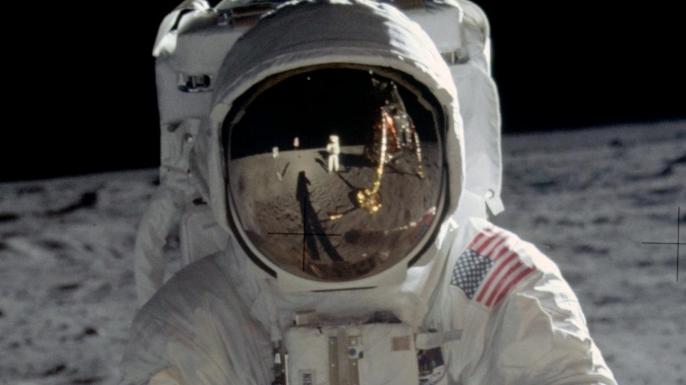 """Astronaut Edwin E. """"Buzz"""" Aldrin walks on the surface of the moon near the leg of the Lunar Module """"Eagle"""" during the Apollo 11. (Credit: NASA)"""