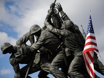 The U.S. flag is raised over the Marine Corps Memorial in Arlington, Virginia on February 23, 2009 during an event honoring veterans of the Battle of Iwo Jima. (Credit: TIM SLOAN/AFP/Getty Images)