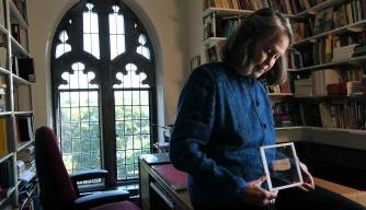 Karen L. King Hollis, Professor of Divinity at Harvard University, in her office with a papyrus fragment of the gospel of Jesus' wife. (Credit: Bill Greene/Getty Images)