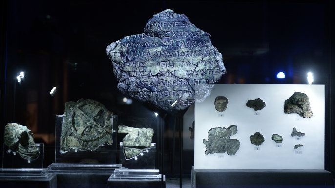 A picture taken at the Archaeological Museum in Athens on September 14, 2014 shows pieces of the Antikythera Mechanism. (Credit: LOUISA GOULIAMAKI/AFP/Getty Images)