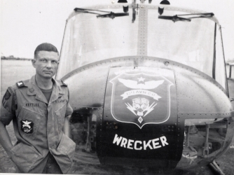 U.S. Army Maj. Charles Kettles, posing in front of a 121st Aviation Company UH-1H, during his second Vietnam tour of duty, 1969. (Credit: Retired U.S. Army Lt. Col. Charles Kettles)