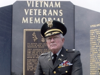 Retired U.S. Army Lt. Col. Charles Kettles poses in front of the Vietnam Veteran's Memorial in Ypsilanti Township, Michigan. (Credit: Retired U.S. Army Lt. Col. Charles Kettles)
