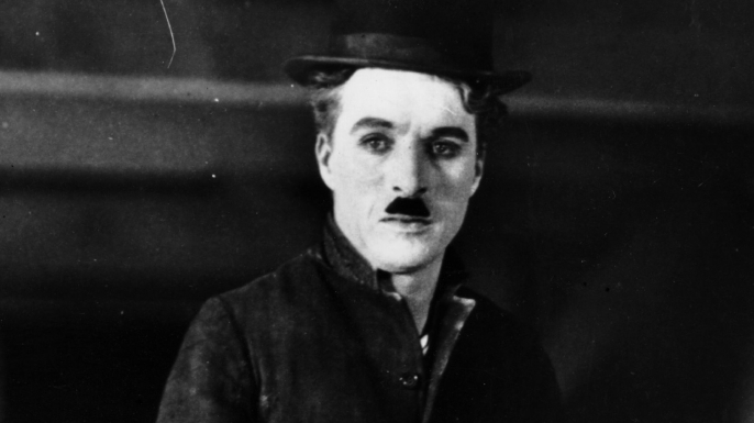 "Charlie Chaplin in character as ""The Tramp."" (Credit: Topical Press Agency/Getty Images)"