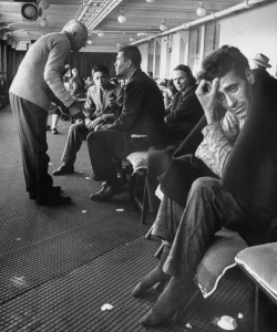 Promenade deck of French Liner le de France occupied by survivors of Andrea Doria.  (Credit: Loomis Dean/The LIFE Picture Collection/Getty Images)