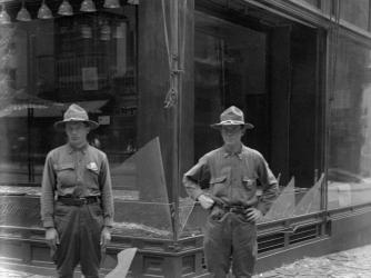 Store windows broken in Black Tom Explosion. (Credit: Bettmann / Getty Images)