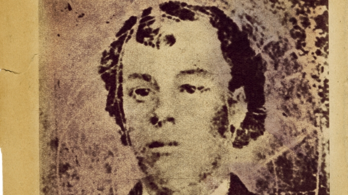 An image of Billy the Kid from his 1877 wanted poster. (Credit: Fototeca Gilardi/Getty Images)