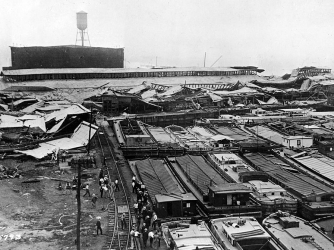 Wrecked warehouses and scattered debris attest to power of an explosion. (Credit: US Army Signal Corps / Getty Images)