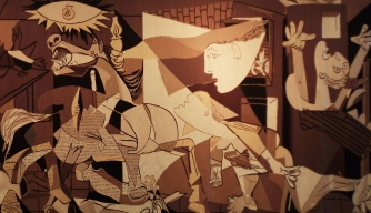 "A life-sized tapestry based on Pablo Picasso's ""Guernica"" on display at the United Nations. (Credit: Dan Kitwood/Getty Images)"