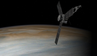An artist's illustration of the Juno spacecraft in orbit above Jupiter. (Credit: NASA)\
