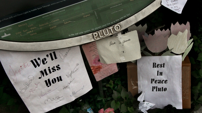 Rest in Peace signs for Pluto near the Smithsonian. (