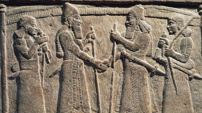 King Shalmaneser III of Assyria meeting a Babylonian, detail from Shalmaneser III's throne, relief on stone.  (Credit: DeAgostini / Getty Images)